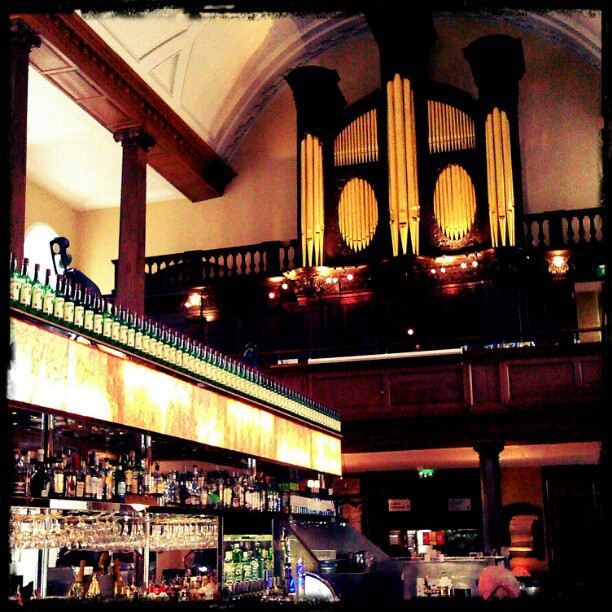 Photo: A bar in a church out a church within a bar?