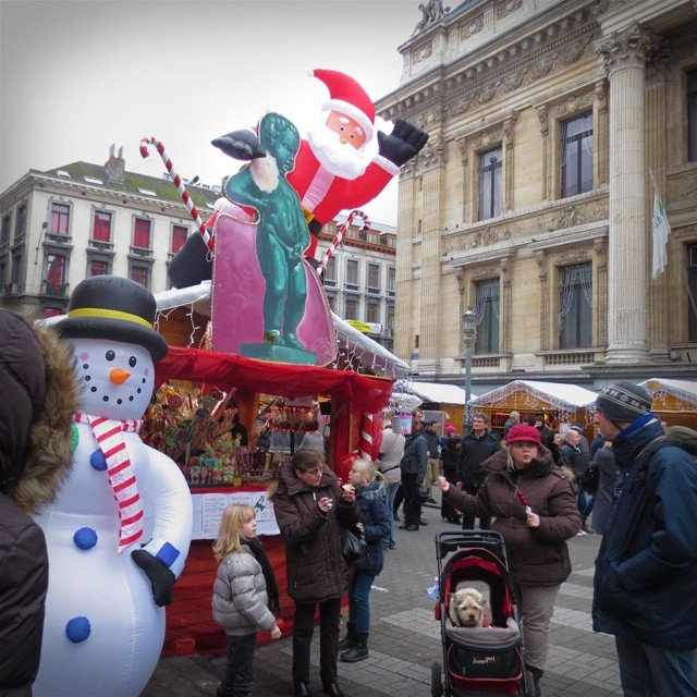 Photo: #Manneken #Pis and #Santa on #Christmas #market stall. In front of it, a #dog in a #pram. #Brussels  #Bruxelles #Kerst