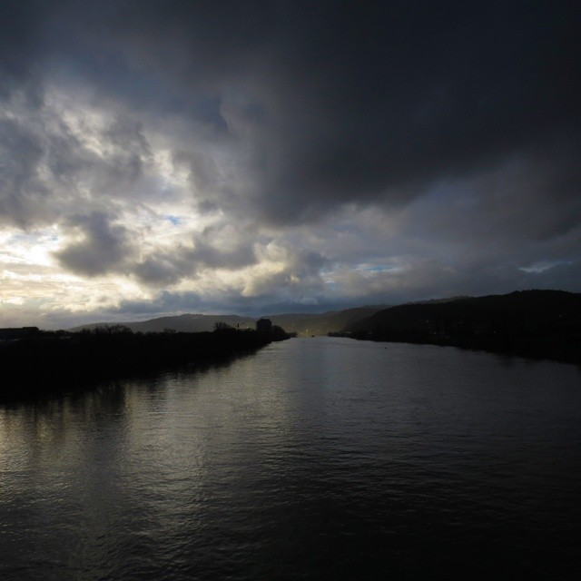 Photo: #Clouds over the #river #Mosel in #Trier. #light #rain #rail #bridge #sun #spell #sunshine #boat #ship  #Germany #dramatic #weather