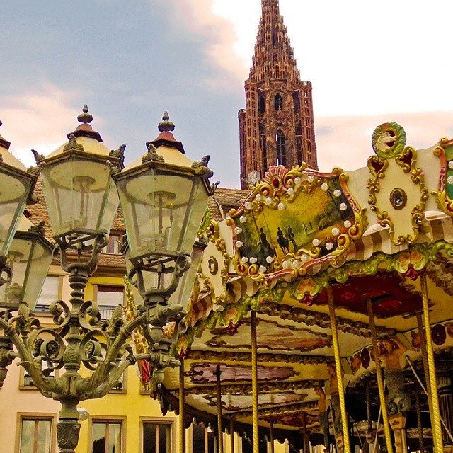 Photo: #Merry-go-round, #cathedral and #vintage #street #lamp in #Strasbourg.