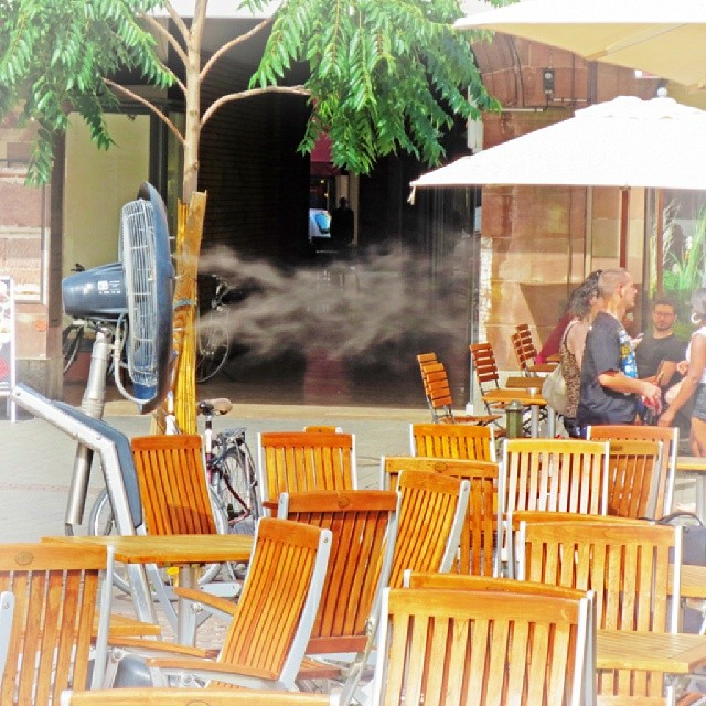 Photo: Want! A #misting #fan at a #café in #Strasbourg. #summer #urban #heat #chilling #cooling #mist #water #fog