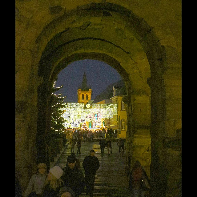 Photo: View through #Porta #Nigra gate onto illuminated/decorated #city centre of #Trier. #Christmas #shopping #Germany #Roman #black #lights