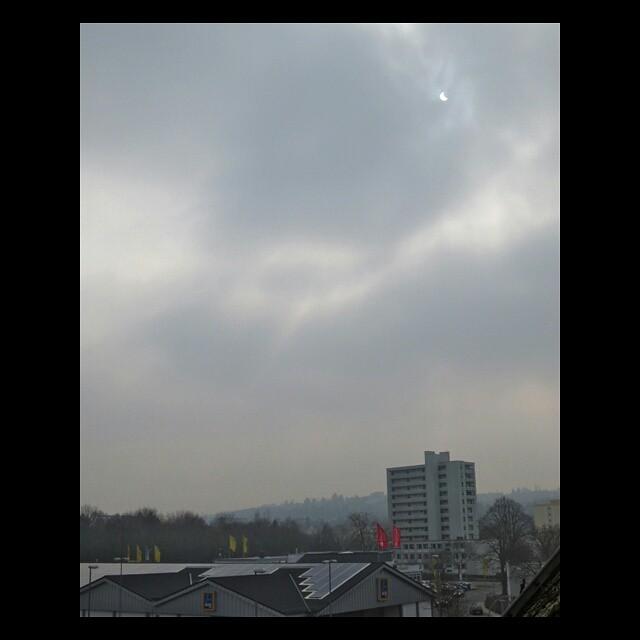 Photo: #Partial #eclipse of the #sun over #Heiligkreuz, #Trier.
