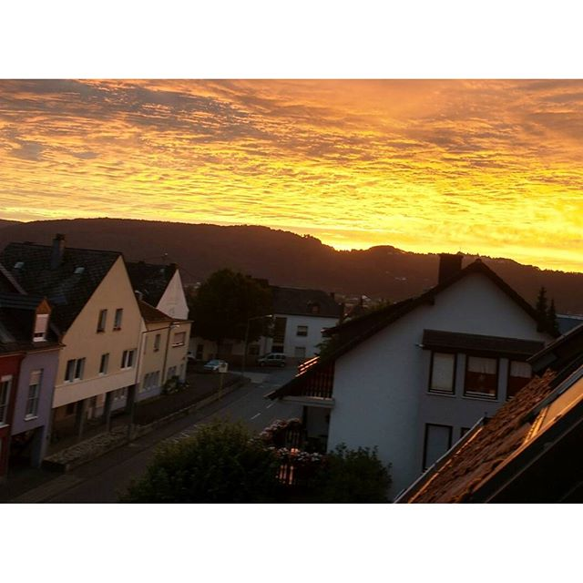 Photo: #Sunset #roof #roofs #Trier  #Heiligkreuz #sun #sky #clouds.